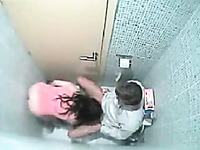 Amateur casual brunette was caught on spy cam while giving BJ in toilet