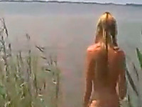 Busty blonde babe on the lake naked gives me head on POV