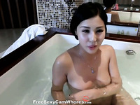 Shameless Chinese temptress is taking a bath for your enjoyment