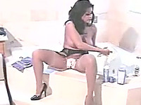 Busty and hot brunette Asian babe filmed on cam while shaving pussy