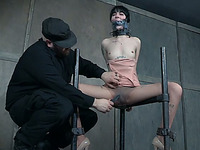 Brunette skinny girl restrained and duct taped for silence