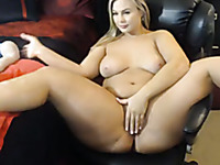 Auburn big breasted MILF tenderly masturbated her wet pussy with a dildo