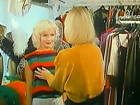 Two playful and joyful blonde ladies eat each other in the dressing room