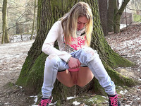 Blonde hot white girl leans on the tree and pisses in the woods