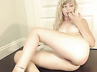 Pallid auburn chick with pretty ass fingers her wet pussy and anus