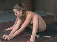 Adorable slender white girl nude and bound on the cold floor