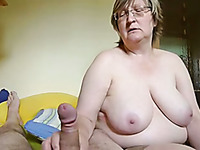 Chubby short haired mature blonde in glasses wanks strong cock