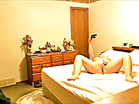 Hidden cam catches MILF sexting and playing with her sex toy
