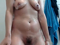 This MILF gets pleasure from showering on cam and she's got a nice ass