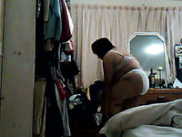 Hidden camera caught chubby Mexican granny changing her clothes