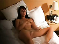 Bosomy brunette hottie tickles her shaved cunt with fingers