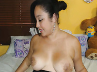 Lovely voracious big breasted brunette fucks herself with a dildo machine