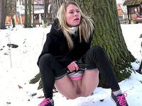 Blonde sweetie in black thermal pants pisses in the park
