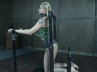 Beautiful blonde white chick shackled to the bars and ducttaped