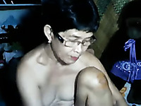 Mature short haired Asian housewife with ugly tits works on webcam
