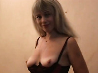 Salty blonde wearing stockings and corset gets her ass spanked