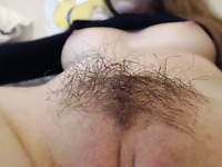 My friend taped on cam the way his slender brunette's hairy pussy looked