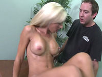 Blond haired big breasted beauty gives a terrific blowjob to her masseur