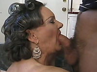 This randy granny loves eating ass and she's got some really nice breasts