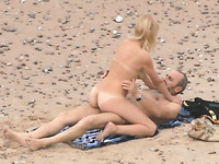 Shameless couple has steamy sex on the beach while being spied on