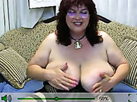 Short haired curly mature lady in glasses and black nightie flashes boobs