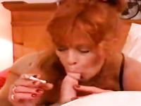 This redhead cougar is a heavy smoker who will suck you off good on camera