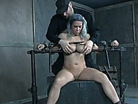 Using stainless steel crossbars to punish my slave's huge succulent boobs