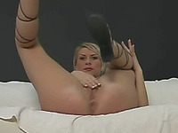 Hot blonde enjoys stuffing her pussy with objects
