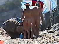 Spying on married couple sunbathing on a nude beach