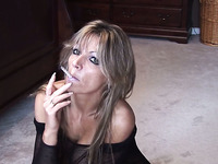 This mature woman's solo smoking session is amazing and I love her big boobs