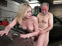 Awesome sexy blonde chick rides older man's strong cock in the garage