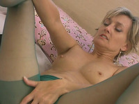 Desirable milf in pantyhose pleasures herself passionately