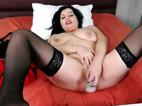 Sexy busty Italian MILF is fucking her snatch with her dildo on camera