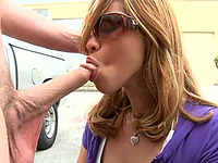 Sultry Latina in sunglasses gives blowjob at the parking lot