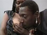 Filthy ebony whore with giant saggy tits gives titjob