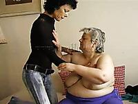 Slender brunette MILF in lesbian scene with SSBBW granny