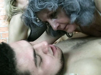 Busty granny joins young couple in bed and gives blowjob