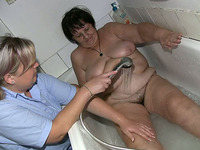 Fat granny gets her fat pussy rubbed by her lesbian friend