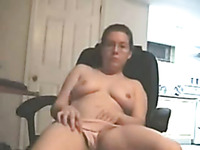 Chubby busty short haired cougar pleasing herself on webcam