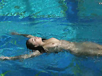 Taking weird poses underwater lovely amateur chick looks nice
