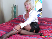 English mature whore plays with her own big boobs and old cunt