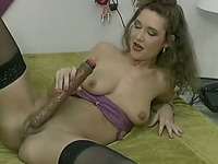 Svelte brunette dirty whore rubs her wet cunt with dildo
