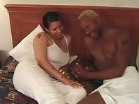 Seductive full-figured black mama has oral sex with black dude