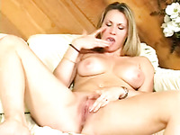 Pallid bitch with big tits is so into tenderly teasing her own pussy