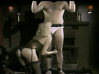 Tied up and masked dude has to stay still while blonde bitch sucks his dick