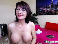 Amateur busty MILF camgirl masturbating on webcam