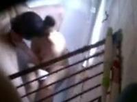 Spy camera catching next door girl sucking cock in the bathroom