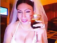 Bosomy webcam whore in bride's dress licks her delicious tits