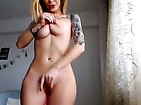 hot blonde model fingering and riding a dildo on cam