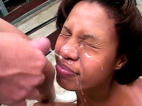 Cute amateur ebony chick sucks hard white dick and takes facial